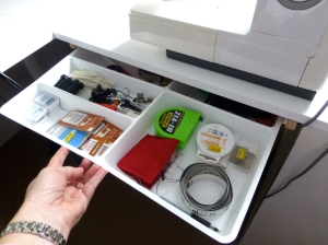 Pull-out drawer directly underneath my sewing machine so all my essentials are accessed quickly and easily.