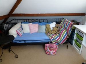 A comfortable day-bed on which I curl up and do a spot of crochet or hand-stitching.