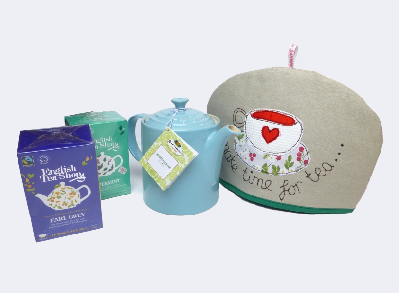 Teapot, tea cosy and teas