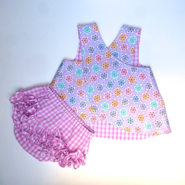 baby wrap over dress and frilly diaper cover