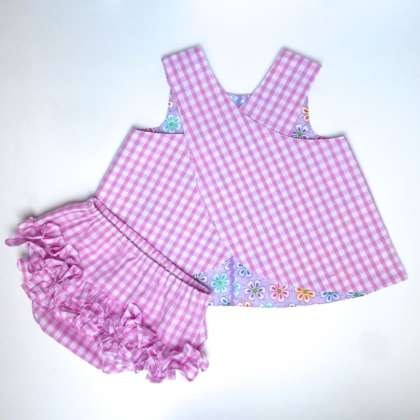 baby wrap over dress and frilly pants back