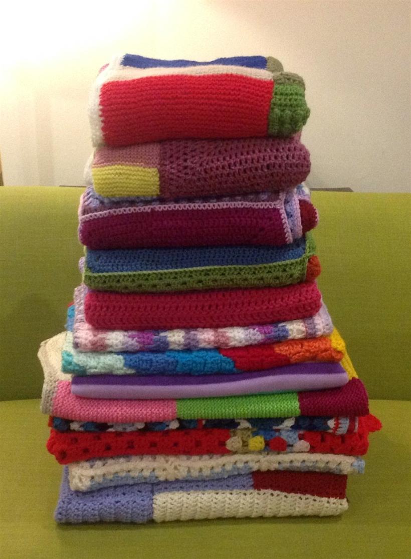 pile of crochet blankets